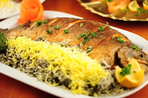 فلسفه خوردن سبزی پلو با ماهی شب عید چیست